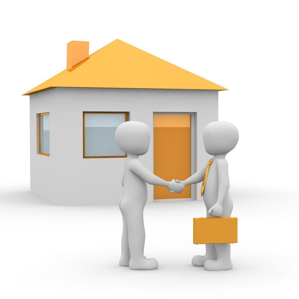 agente inmobiliario asesorando para comprar mi primera casa